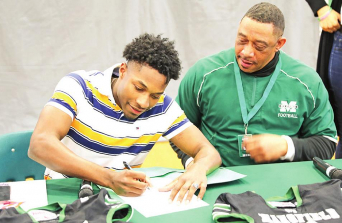 MHS's Justin Davis and Adrian Green Sign to Play Collegiate Level Football