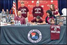 Wrestler Josh Sarpy Makes History at NDHS Signing with D1 University
