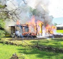 DeSoto Fire District 1 Sets Control Burn Fire to Logansport Home