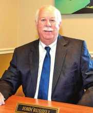 Community Bank Announces Retirement of John G. Russell