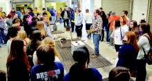 Students from area schools watch the Metal Pour demonstration during NSU's Art Extravaganza.
